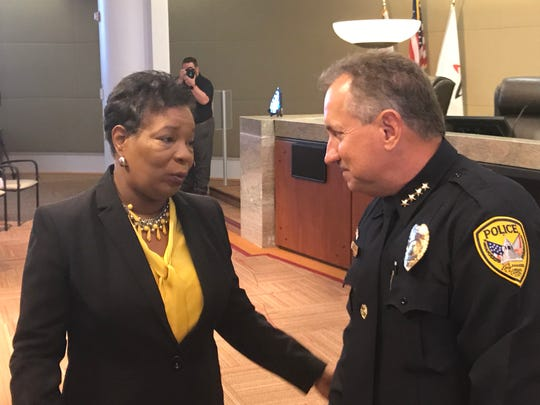 Tallahassee Police Department Interim Chief Steve Outlaw speaks with Deputy City Manager Cynthia Barber after being sworn in Monday