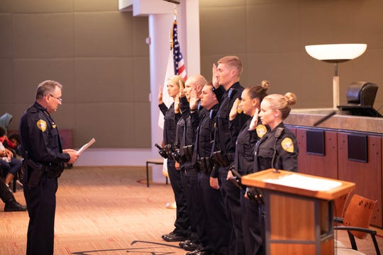Interim TPD Chef Steve Outlaw swears in seven new officers on Monday