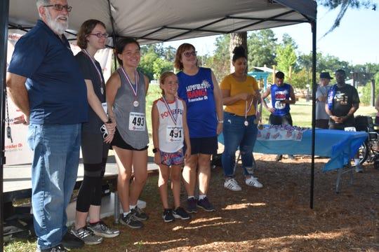 Award presentation at Thursday's Firecracker 5K held at Cascades Park.