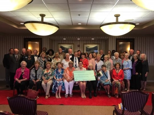 Tallahassee Symphony Society presented the Mandy Stringer with a check for $17, 000 the proceeds from its l December Tour Of Homes.