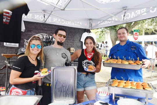 American Icon Brewery's Sarah Claudio, Chad Brown, Jessy Rodriguez and Michael Braseth serve burgers at the 2019 United Against Poverty's Burgers & Brews Festival in downtown Vero Beach.