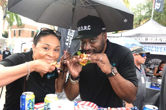 Ericka and Henry Stewart, of Senior Life Services, enjoy their burgers at the 2019 United Against Poverty's Burgers & Brews Festival in downtown Vero Beach.