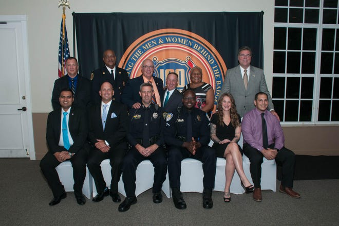 Recipients of the 2019 First Responder Awards, seated, with their agency heads, standing, from left, Trooper Mithil Patel and Capt. Ryan Lloyd of the Florida Highway Patrol; Firefighter Kevin Whitaker and Assistant Chief Derek Fox of St. Lucie County Fire District;  Officer Scott Marreel and Chief John Bolduc, of Port St. Lucie Police Department; Hundred Club President Jason Berger; Detective Willis Tumblin and Chief Diane Hobley-Burney, of Fort Pierce Police Department;  Corrections Deputy Jennifer Keefe and Detective David Dionisio, with Sheriff Ken Mascara, of St. Lucie County Sheriff's Office.