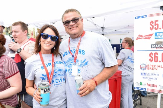 Treasure & Space Coast Radio's Karen Franke with John Franke at the 2019 United Against Poverty's Burgers & Brews Festival in downtown Vero Beach.