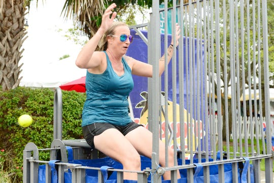 Jessica Lummis in the dunk tank at the 2019 United Against Poverty's Burgers & Brews Festival in downtown Vero Beach.