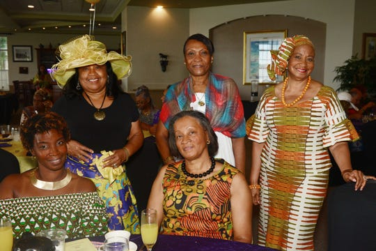 Karlene and Polly Green, seated, with Joyce Smith, standing, left, Marilyn Anderson and Grace Bordley at the Caribbean American Cultural Group's High-Tea, Fashion Show and Silent Auction at the Ballantrae in Port St. Lucie.