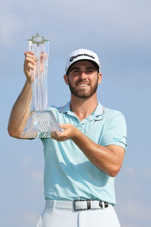 Westlake High graduate Matthew Wolff poses with the trophy after winning the 3M Open in Blaine, Minnesota, on Sunday. The 20-year-old earned his PGA Tour card by winning a title in just his third tournament after turning pro.
