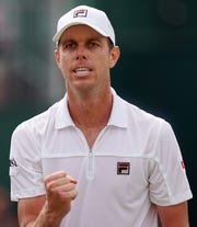 Thousand Oaks High graduate Sam Querrey reacts during his four-set win over fellow American Tennys Sandgren in the fourth round of Wimbledon on Monday. Querrey faces Rafael Nadal in the quarterfinals Wednesday.