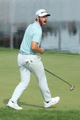 Westlake High graduate Matthew Wolff celebrates after sinking a long eagle putt on the 18th hole that helped the 20-year-old win the 3M Open in Blaine, Minnesota, on Sunday.