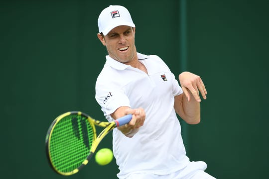 Sam Querrey hits return during his fourth-round match against Tennys Sandgren at Wimbledon on Monday. The Thousand Oaks High graduate won in four sets and will face Rafael Nadal in the quarterfinals Wednesday.