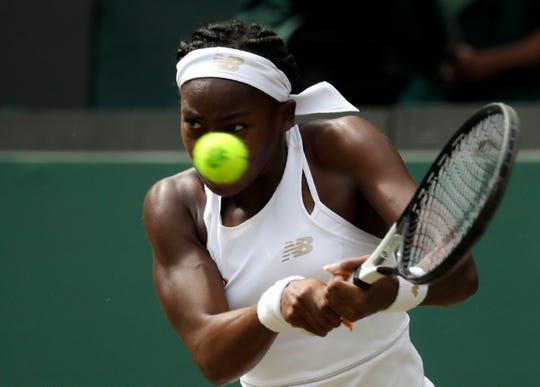 Coco Gauff returns a shot against  Simona Halep in a fourth-round match Monday at Wimbledon. The 15-year-old American lost to former No. 1 Halep, 6-3, 6-3.