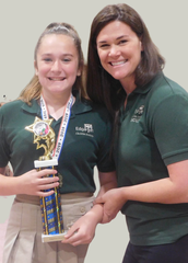 """Grace Stanker, a seventh grader who placed first overall in Edgarton Christian Academy's Science Fair with her project, """"What Type of Coffee from Starbucks Will Affect Your Heartrate The Most?,"""" shares a happy moment with Leah Frie, science teacher and fair coordinator."""