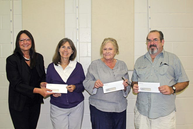 (From left) Donna Vertolli, member of the board of trustees of The Guidance Center, presented checks and congratulated Karen Petsch, Linda Pendergrass and Terry Wilson, winners of the 2019 Friends of The Guidance Center 50-50 Raffle. The winners, who are center employees, purchased one ticket and shared the top prize of $12,000. Proceeds from the raffle will benefit the center, which is a comprehensive mental health center providing professional services and programs for the greater Cumberland County community. For information, call (856) 825-6810 or visit www.ccgcnj.org.