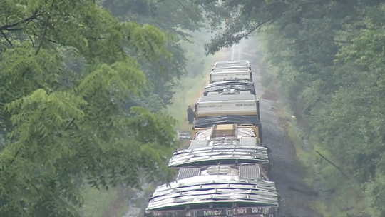 Officials responding to the scene of a person struck by a freight train near Newark Monday.