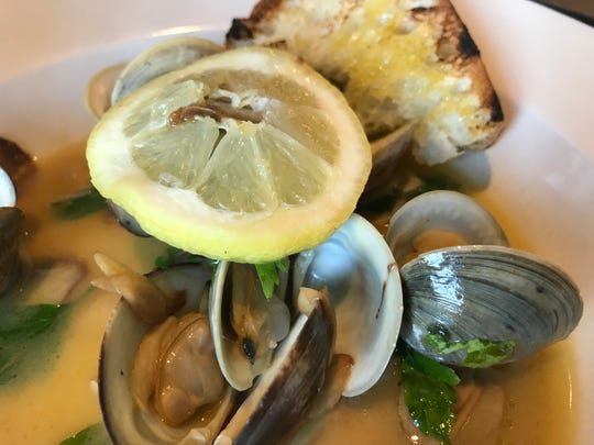 The new Taverna restaurant in Wilmington does a simple dish of steamed clams in butter, wine and garlic very well.