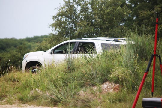 This vehicle in this photo taken Sunday was discovered near Lake Cooper in Archer County. An Olney woman's body was found Sunday afternoon near the lake. Texas Rangers are investigating. Photo provided by the Archer County News.