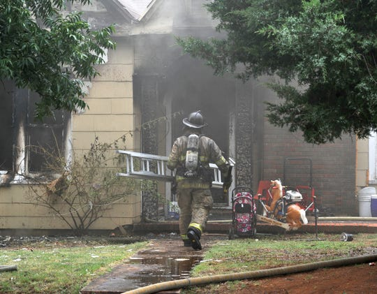 Wichita Falls firefighters work to control a house fire in the 2100 block of Avenue J, Monday afternoon. The cause of the fire is under investigation.