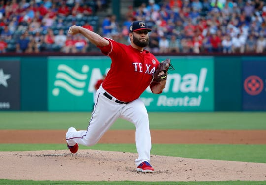 Texas Rangers starting pitcher Lance Lynn (35) works against the Los Angeles Angels in the first inning of a baseball game in Arlington, Texas, Thursday, July 4, 2019. (AP Photo/Tony Gutierrez)