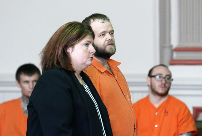 Christopher Stamm listens to the proceedings during his sentencing hearing in Muskingum County Common Pleas Court.