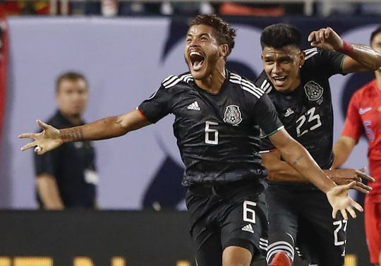 Jonathan dos Santos celebrates after scoring against the United States.