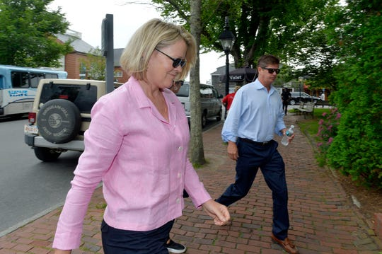 Heather Unruh arrives with her husband and son (not shown) at the latest pretrial hearing in the Kevin Spacey criminal groping case in Nantucket, Mass., on July 8, 2019. She accused Spacey of groping her son in July 2016.