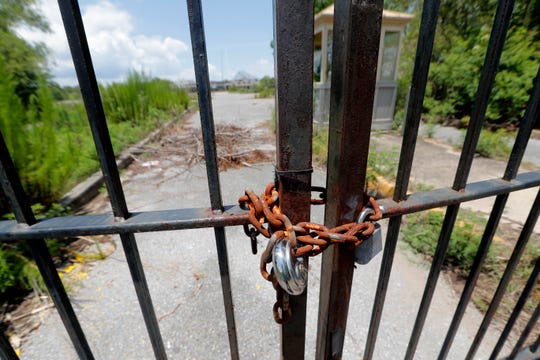 This June 19, 2019, photo shows the gates of the abandoned Six Flags amusement park in New Orleans.