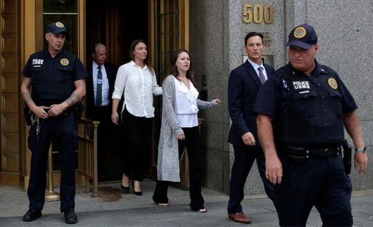 Michelle Licata, right, and Courtney Wild, left, alleged victims of financier Jeffrey Epstein, depart Federal Court in Manhattan with their lawyer Bradley Edwards on July 8, 2019.