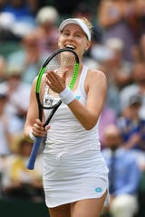 Alison Riske celebrates victory in her fourth-round match against Ashleigh Barty.