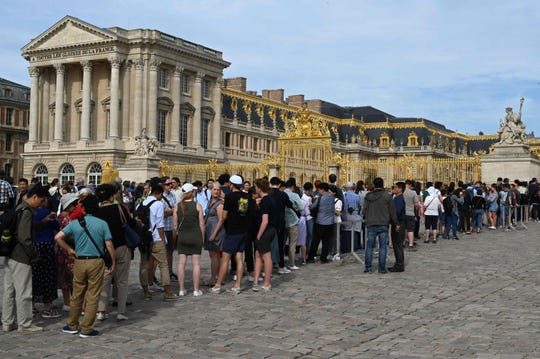 Tourists line up outside the Palace of Versailles, home to French rules from 1682 until the revolution of 1789.