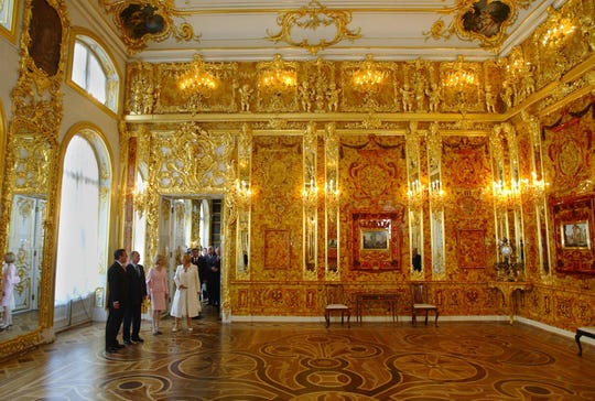 Russian President Vladimir Putin shows off the fully restored Amber Room in May 2003.