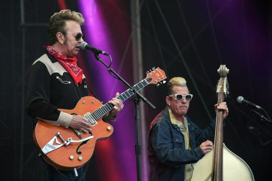 Brian Setzer and bassist Lee Rocker, of the band the Stray Cats, performs during the 31th Eurockeennes rock music festival in Belfort, eastern France, on July 7, 2019.