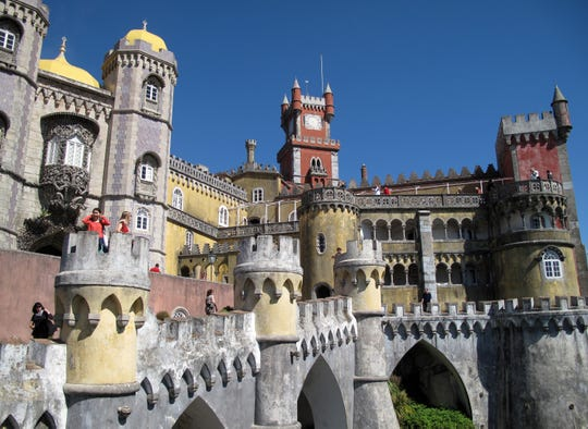 Portugal's Pena Palace is a crazy, colorful, Neo-fortified casserole of Gothic towers, Renaissance domes, Moorish minarets, Manueline carvings, and Disneyland playfulness.
