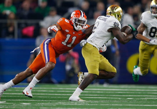 Clemson linebacker Isaiah Simmons tackles Notre Dame running back Dexter Williams during the 2018 Cotton Bowl.