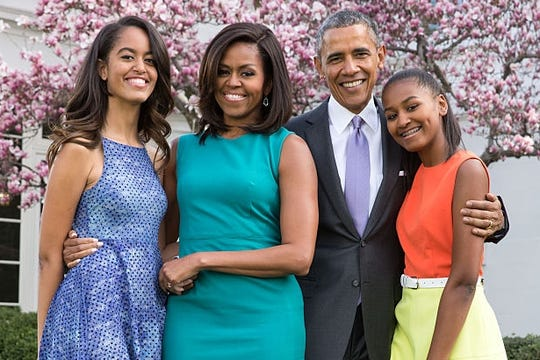 Former President Barack Obama, Former First Lady Michelle Obama, and daughters Malia and Sasha pose for a family portrait in the Rose Garden of the White House.