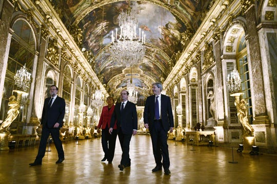 European heads of state confer in Versailles' Hall of Mirrors.