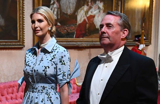 Ivanka Trump, left, President Donald Trump's daughter, and British International Trade Secretary, Liam Fox, comes through the East Gallery during a State Ball in the Ballot Room in Buckingham Palace in central London on 3 June 2019.