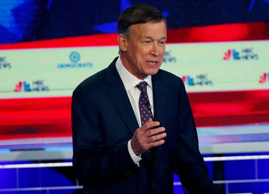 "In this June 27, 2019 file photo, Democratic presidential candidate and former Colorado Gov. John Hickenlooper speaks during the Democratic primary debate hosted by NBC News at the Adrienne Arsht Center for the Performing Arts, in Miami. Hickenlooper says of his presidential campaign struggles that ""the vast majority of the problem with the campaign was me."" But the Democrat promised Sunday, July 7 to stay in the race and become a better candidate. His own staff has called for him to exit the presidential race and run for Senate instead."