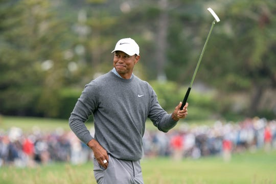 Tiger Woods acknowledges the crowd on the 18th green during the third round of the 2019 U.S. Open golf tournament at Pebble Beach Golf Links.