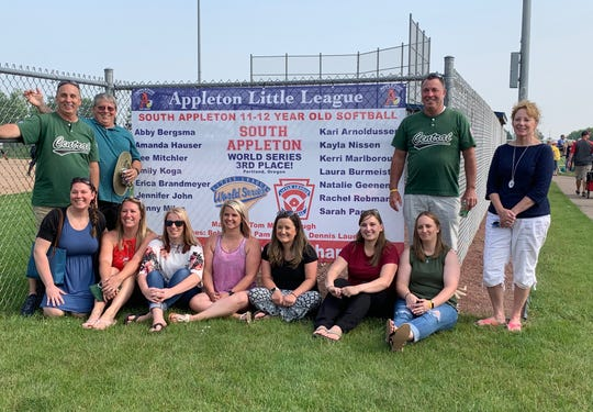 The South Appleton Little League softball team had a reunion Sunday to commemorate the 20th anniversary of the team advancing to the Little League World Series. Pictured are, front row (from left):  Amanda Hauser, Jenny (Miles) Wendel, Deanna (Mitchler) Pingel, Rachel (Rebman) Golden, Laura (Burmeister) Roberts, Kayla (Nissen) Stingl, Kerri (Marlborough) Jentz. Back row: Coaches Bob Nissen, Denny Lauer, Tom Marlborough, Pam Mitchler.