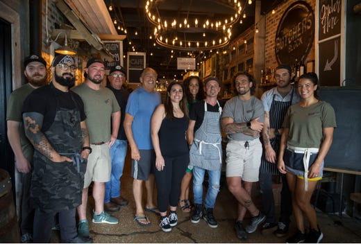 The team behind The Butcher's Block, a newly opened restaurant in Long Branch. Owner Tom D'Ambrisi is third from left. The restaurant shares a roof with D'Ambrisi Wholesale Foods, a meat distribution business owned by his father, Rudy, (fifth from right), and brother, Rudy Jr. (not pictured).