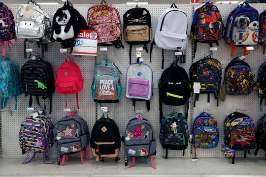 This 2018 photo shows a display of back to school backpacks in a Target store in Pittsburgh. For backpacks, Mary Hunt, founder of the website Cheapskate Monthly, recommends Jansport or Eastpak for durability. If you are shopping resale, those are labels to look for because they'll last longer.