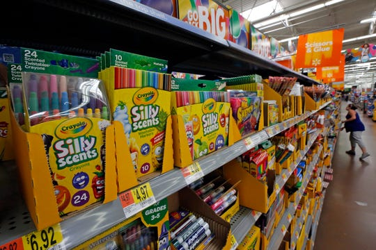 """This 2018 file photo shows a display of scented markers and crayons in a Walmart in Pittsburgh. Environmentally friendly school supplies often carry big prices, but if you expand your idea of what counts as """"green,"""" you'll open other ways to save."""