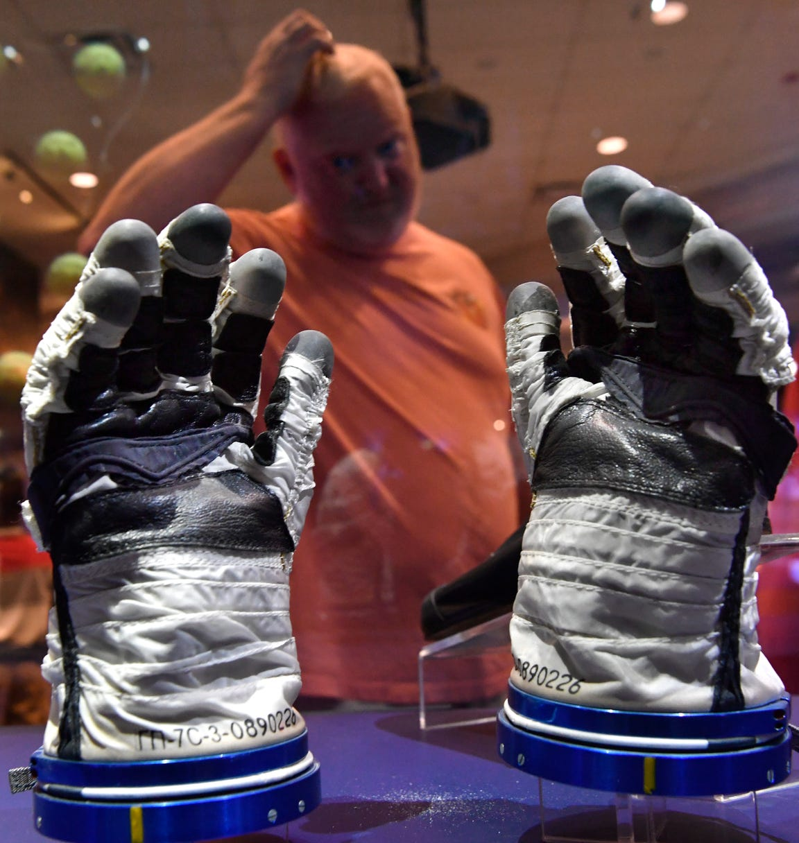 Jason Hammons looks at the Sokol spacesuit gloves worn by astronaut Scott Kelly at the start of his tour aboard the International Space Station. Hammons was visiting Space Center Houston from Lubbock with his family.