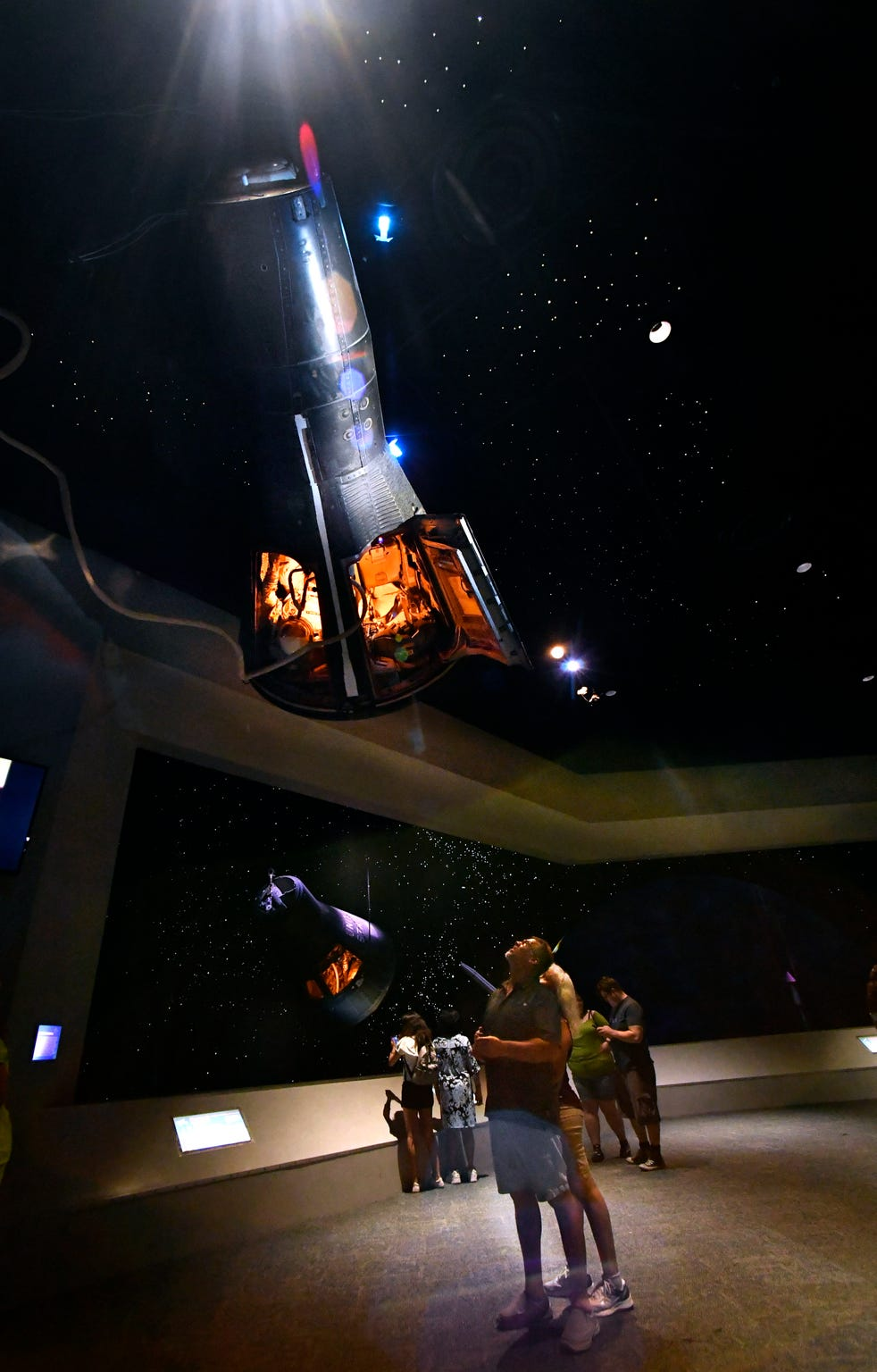 Brandon Littlelight looks at the Gemini V capsule, suspended from the ceiling in Starship Gallery, with his wife Tawnya. The couple were visiting Space Center Houston from Seattle.