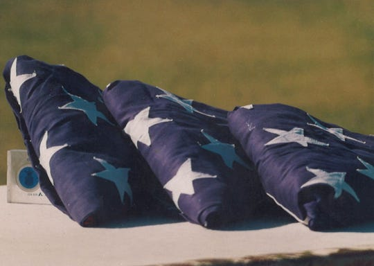 Three flags symbolized fallen airmen at a memorial service for those who died in a B-1B crash Sept. 28, 1987.