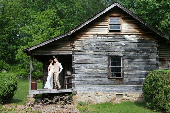 Pauline and Lee Heyne celebrated their 2013 wedding at Pisgah View Ranch, posing at one of the cabins. Pauline is the SAHC director of philanthropy.