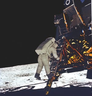 The crowning achievement for the Saturn V rocket came when it launched Apollo 11 astronauts, Neil Armstrong, Buzz Aldrin, and Michael Collins, to the Moon in July 1969. In this photograph, astronaut Aldrin takes his first step onto the surface of the moon.