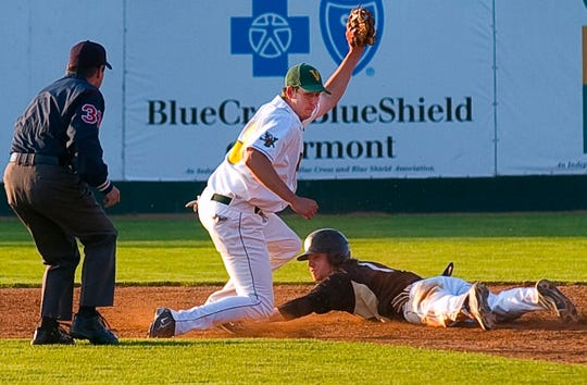 The University of Vermont's Matt Duffy (center) tags out Bryant College's Nick Campbell at second base druing the men's baseball team's final regular-season home game at Centennial Field in Burlington on Tuesday, May 12 2009.