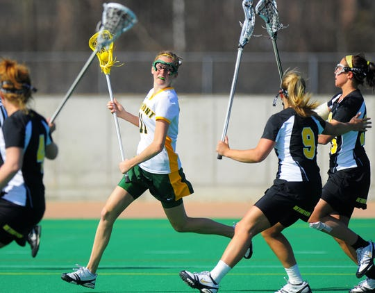 The University of Vermont's Kristen Millar looks to pass the ball against the University of Maryland-Baltimore County's in Burlington on Saturday March 28, 2009.  For more photos from the game, visit the gallery at www.burlingtonfreepress.com.
