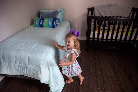 Madison Robertson, 3, plays in her new bedroom in her new home on Tuesday, July 9, 2019. The family of eight had been living in a tiny home after an extension of their home was damaged during Hurricane Harvey. It was rebuilt with the help of several agencies.
